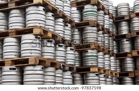 Beer kegs in rows outdoor - stock photo