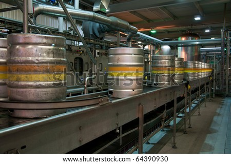 Beer kegs on the production line in the factory - stock photo