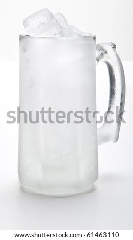 Beer mug filled with ice cubes - stock photo