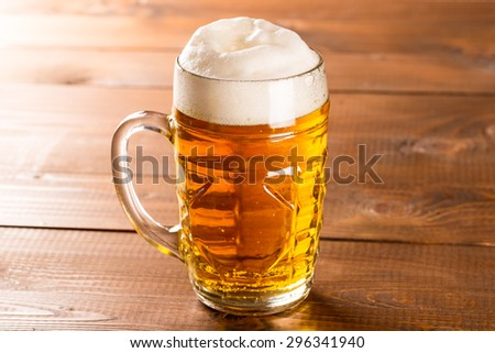Beer mug on rustic wooden table - stock photo