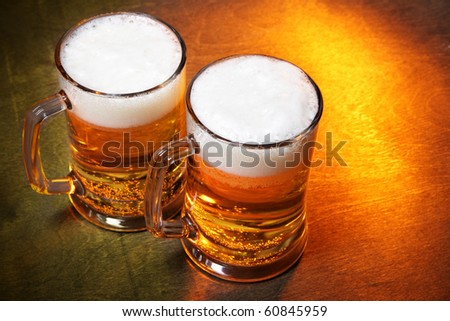Beer mugs close up on wooden table