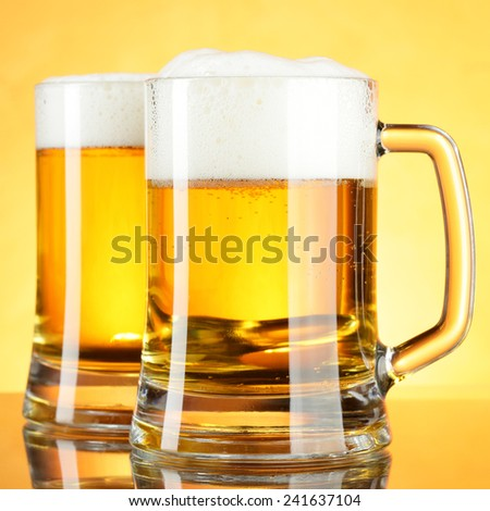 Beer mugs with froth close up - stock photo