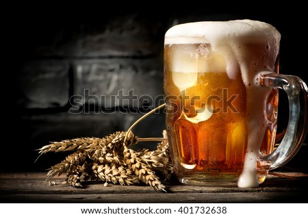 Beer near brick wall - stock photo