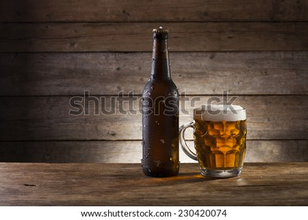 Beer on a wooden background with copy space - stock photo