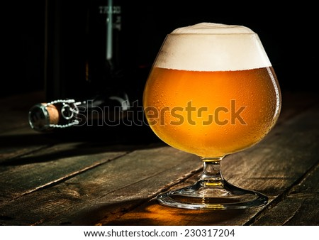 Beer on Rustic Wood Surface - stock photo