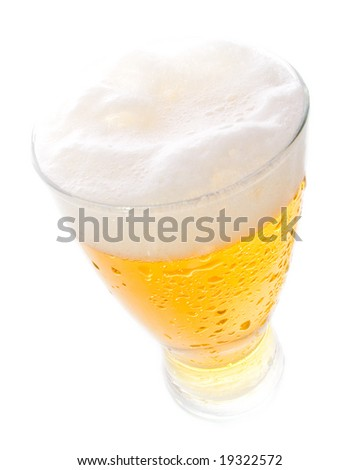 Beer on tall glass shot with wide angle lens - stock photo