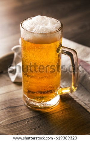 beer on wooden background closeup