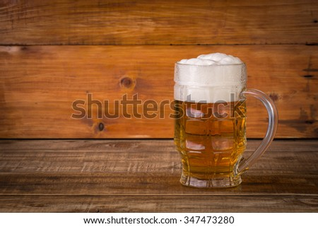 beer on wooden background of boards