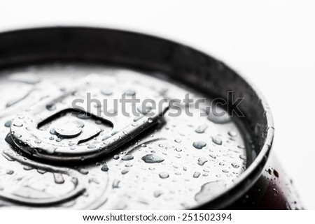 Beer or soft drink can with dew drops - stock photo