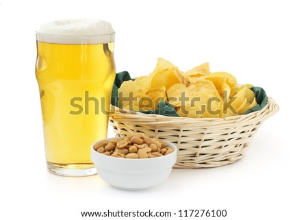beer pint with peanuts bowl and basket of crisps - stock photo