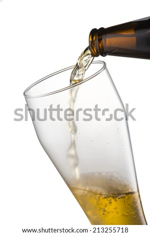 Beer pour from bottle into  glass