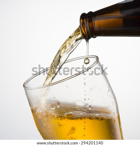 Beer Pour from Bottle to Glass - stock photo