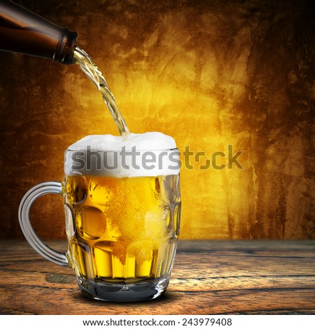 Beer Pour into Glass on Wood Table