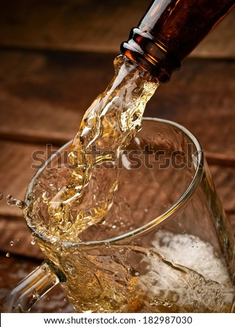 Beer pouring in a mug - stock photo