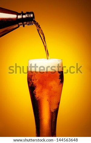 Beer pouring into glass - stock photo