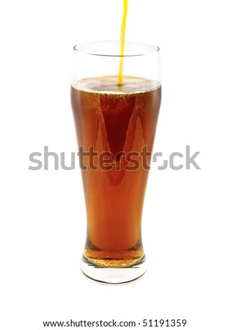 Beer pouring into glass on the white