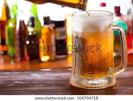 Beer pouring into mug - stock photo