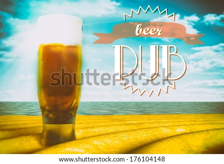 Beer pub sign with glass on beach - stock photo