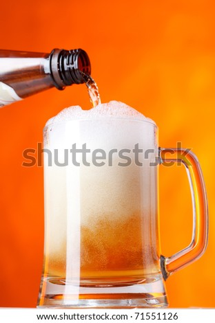 Beer pver orange background