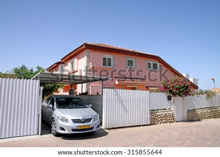 BEER SHEVA, ISRAEL - MARCH  08, 2014: Parking the car next to the cottage in a quiet residential area