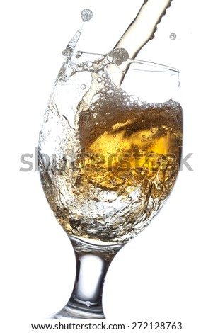 Beer splash in a glass, isolated on white background