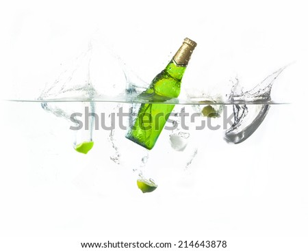 beer splashing with lime and ice cube