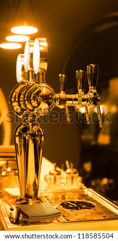 Beer taps in a bar for spilling drinks - stock photo
