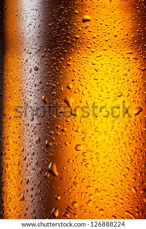 Beer. Texture of water drops on the bottle - stock photo