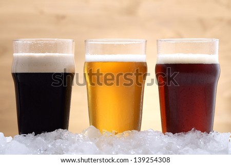 beer three glass  with  beer cold on ice