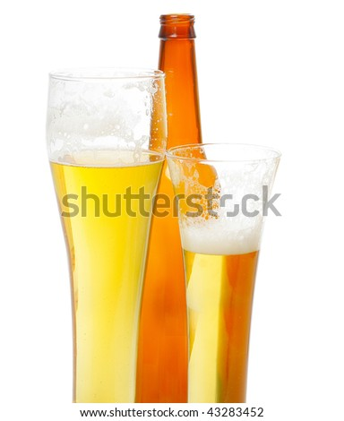 Beer with foam in tall glasses and bottle