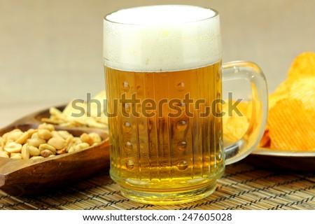Beer with foam snack. - stock photo