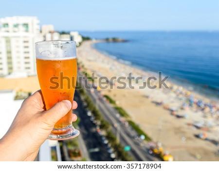 Beer with Rio de Janeiro, Brazil beach background - stock photo