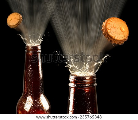 Beers popping spray and caps.. - stock photo