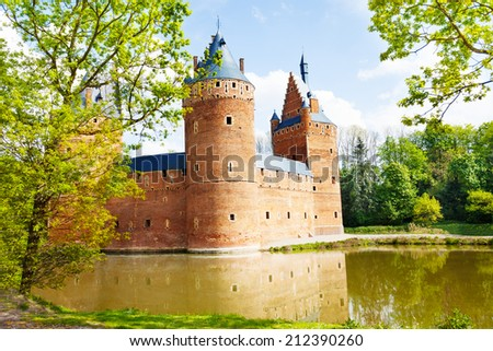 Beersel Castle, Brussels reflecting in river - stock photo