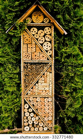 Bees hotel -  construction made from natural materials to help solitary bees and other insect-pollinators  in reproduction. - stock photo