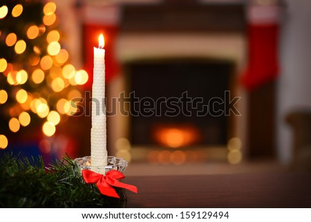 bees wax christmas candle focus on candle - stock photo