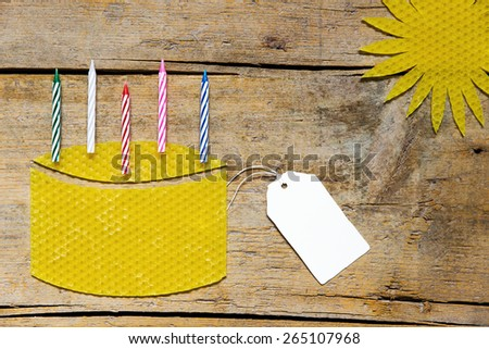 Beeswax cake with blank sign - stock photo