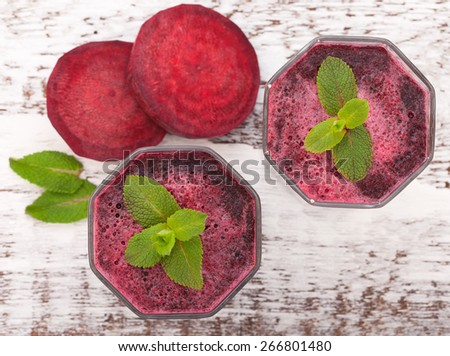 Beet juices and vegetables on white wooden table top view. Closeup selective focus - stock photo