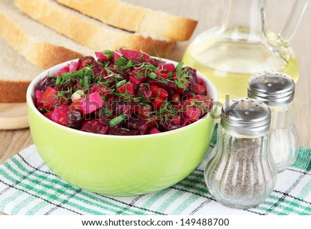 Beet salad in bowl on table close-up - stock photo