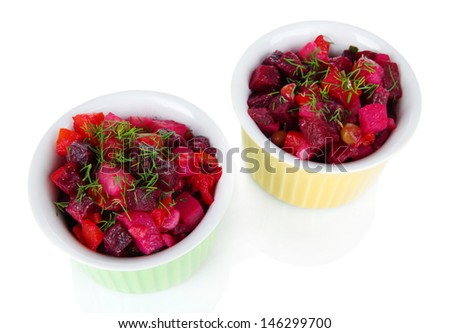 Beet salad in bowls isolated on white