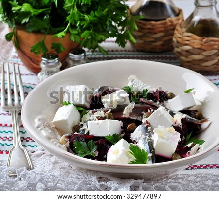 beet salad with goat cheese, anchovies, capers, parmesan cheese, parsley and olive oil