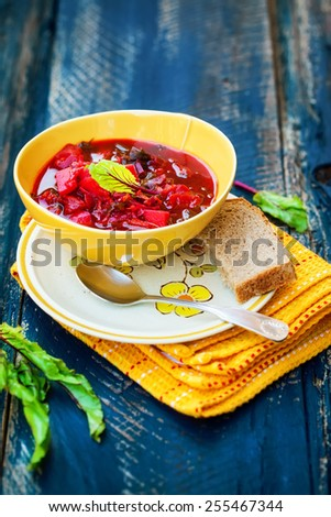 Beet soup - borsch on blue wooden background. Also available in horizontal format. - stock photo