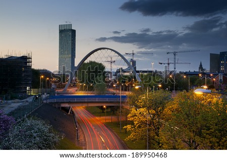 Beetham tower the tallest building in manchester and Hulme Arch bridge over princess road.