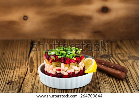 Beetroot and white been salad with pickles, traditional Russian salad vinaigrette - stock photo