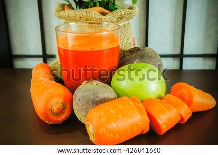 Beetroot, apple, carrot, juice - stock photo