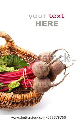 beetroot bunch in a basket isolated on white - stock photo
