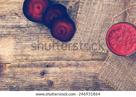 Beetroot drink on a wooden table - stock photo