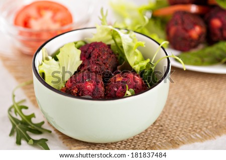 Beetroot falafel served with salad in a bowl - stock photo