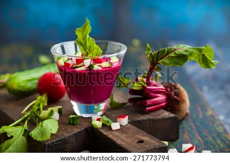 Beetroot gazpacho soup with cucumber and radish in  glass. Soft focus - stock photo