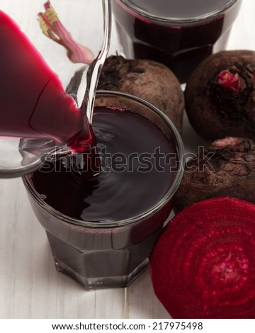 Beetroot juice for healthy drink on white wood